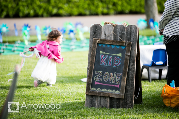 Kid zone sign at wedding for kids to play with babysitters at a Sonoma destination wedding by destination wedding planner Jamie Chang of Mango Muse Events.