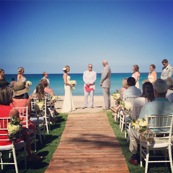 Beach outdoor ceremony at a destination wedding at the Mauna Kea resort in Hawaii designed by destination wedding planner, Jamie Chang of Mango Muse Events.