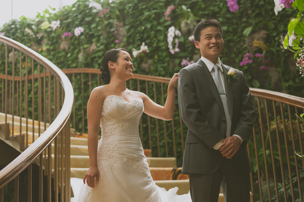 Happy smiling couples do a first look where a groom sees his bride for the first time at a destination wedding in Hawaii by Jamie Chang destination wedding planner of Mango Muse Events.