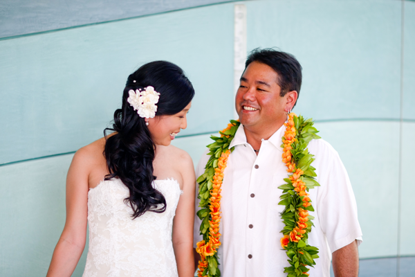 Newlyweds smile at each other at their destination wedding in Hawaii by Jamie Chang destination wedding planner of Mango Muse Events.