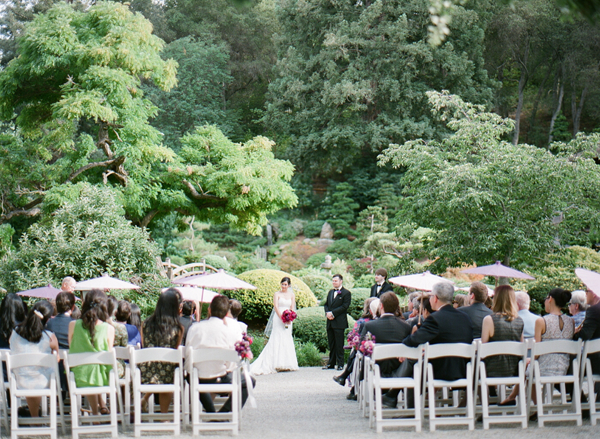 Parasols at an outdoor summer wedding by Jamie Chang destination wedding planner of Mango Muse Events.