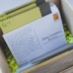 Seating card box at an outdoor wedding including seating cards for kids planned by Destination wedding planner Jamie Chang of Mango Muse Events.