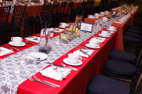 Red and grey wedding table design, by Jamie Chang of Mango Muse Events.