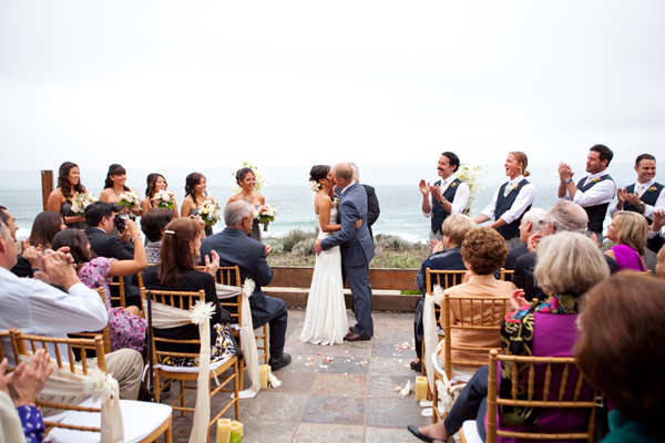 Couple kissing after their outdoor destination wedding ceremony in Half Moon Bay. Event design by Jamie Chang of Mango Muse Events.