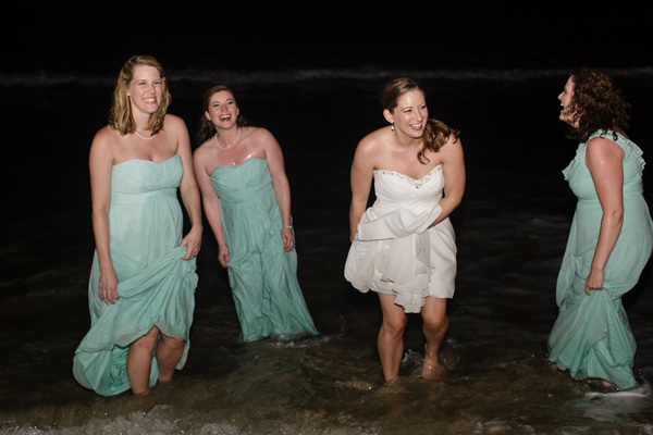 Bridal party in the ocean on the wedding day at a destination wedding in the Caribbean by Jamie Chang Destination Wedding Planner of Mango Muse Events