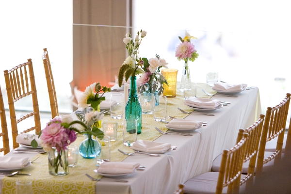 Use vintage vases for you wedding table decor. Destination Wedding in Half Moon Bay. Event design by Jamie Chang destination wedding planner of Mango Muse Events.