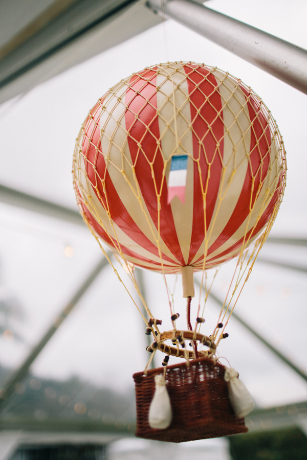 Wedding design using miniature hot air balloons at a destination wedding in Hawaii. Event design by Jamie Chang of Mango Muse Events.