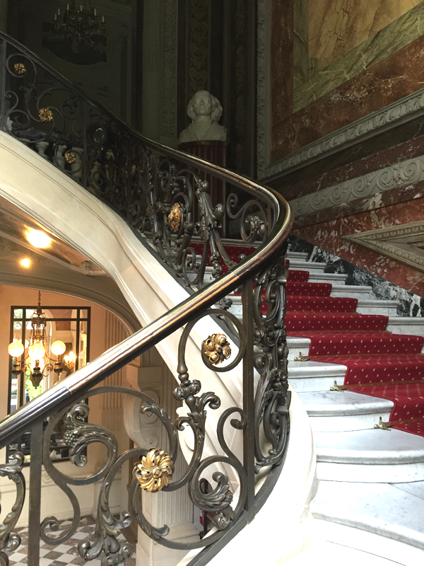 View from below the Grand Staircase at the Salons France Ameriques a destination wedding venue in Paris