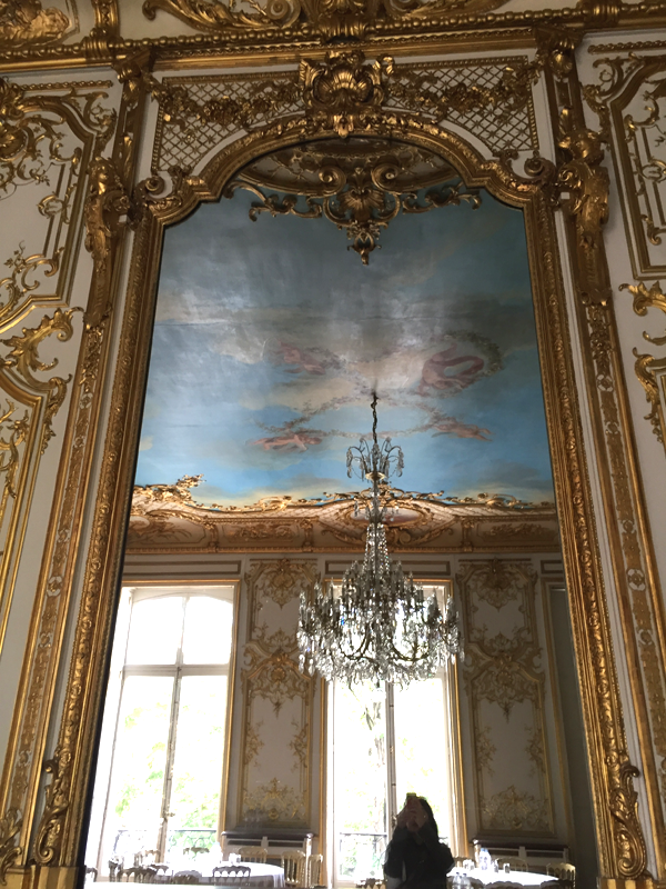 Large wall mirror in the Washington room at the Salons France Ameriques a destination wedding venue in Paris