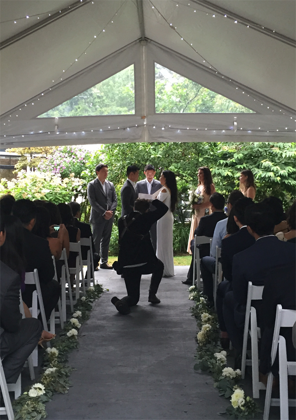 Destination wedding Vancouver. Wedding ceremony under tent. Event design by Jamie Chang of Mango Muse Events.