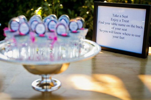 Cupcake seating cards and a fun wedding sign at a fun Sonoma destination wedding designed by Destination wedding planner Jamie Chang at Mango Muse Events