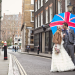 Wedding couple with umbrella at a London destination wedding shared by Destination wedding planner, Mango Muse Events