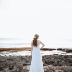 Bride in her wedding dress at her Hawaii destination wedding planned by Destination wedding planner Mango Muse Events