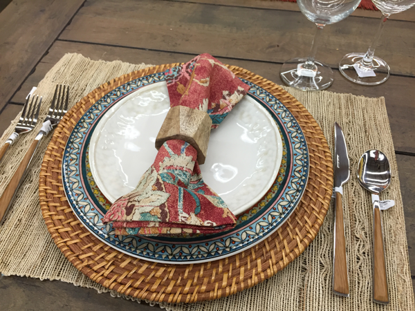 Use a wooden napkin holder for an outdoor, natural theme idea for Thanksgiving table setting.