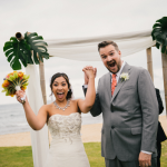 And excited couple just after they are pronounced husband and wife at a Hawaii destination wedding by destination wedding planner, Mango Muse Events