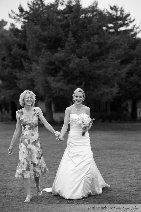 Bride and Mother of Bride walking hand in hand at Quail Lodge in Carmel at wedding coordinated by Jamie Chang of Mango Muse Events