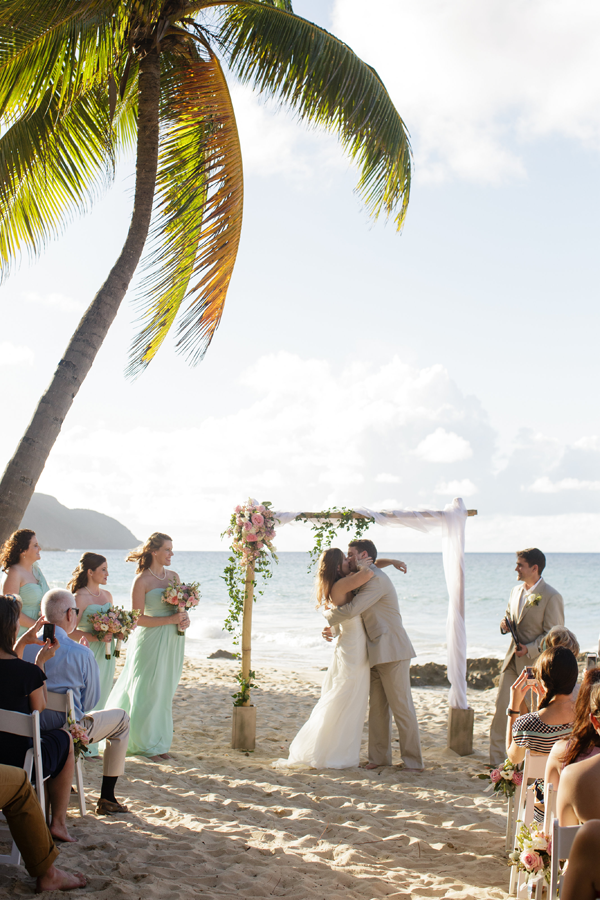 Caribbean destination wedding ceremony on the beach in St. Croix USVI and planned by Destination wedding planner Mango Muse Events