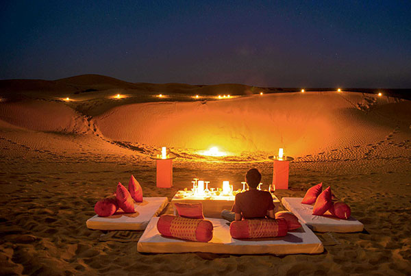 A romantic candlelit lounge in the middle of the desert in Rajasthan India