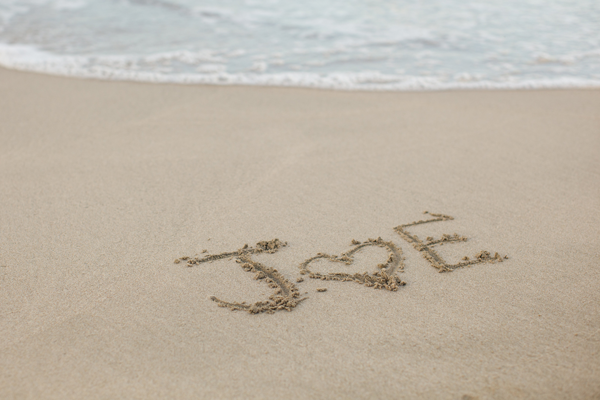 Draw your initials in the sand for a beach destination wedding