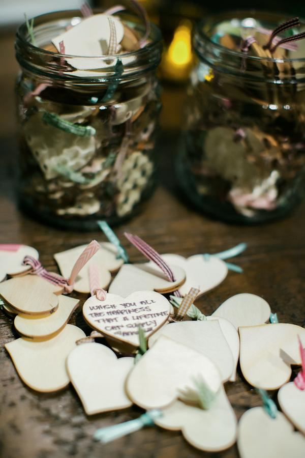 Valentine's wedding inspiration: Have your guests sign wooden hearts as your guest book. Event design by Jamie Chang destination wedding planner of Mango Muse Events.