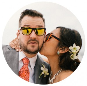 Bride and groom sunglasses kiss Hawaii destination wedding by Destination wedding planner Mango Muse Events