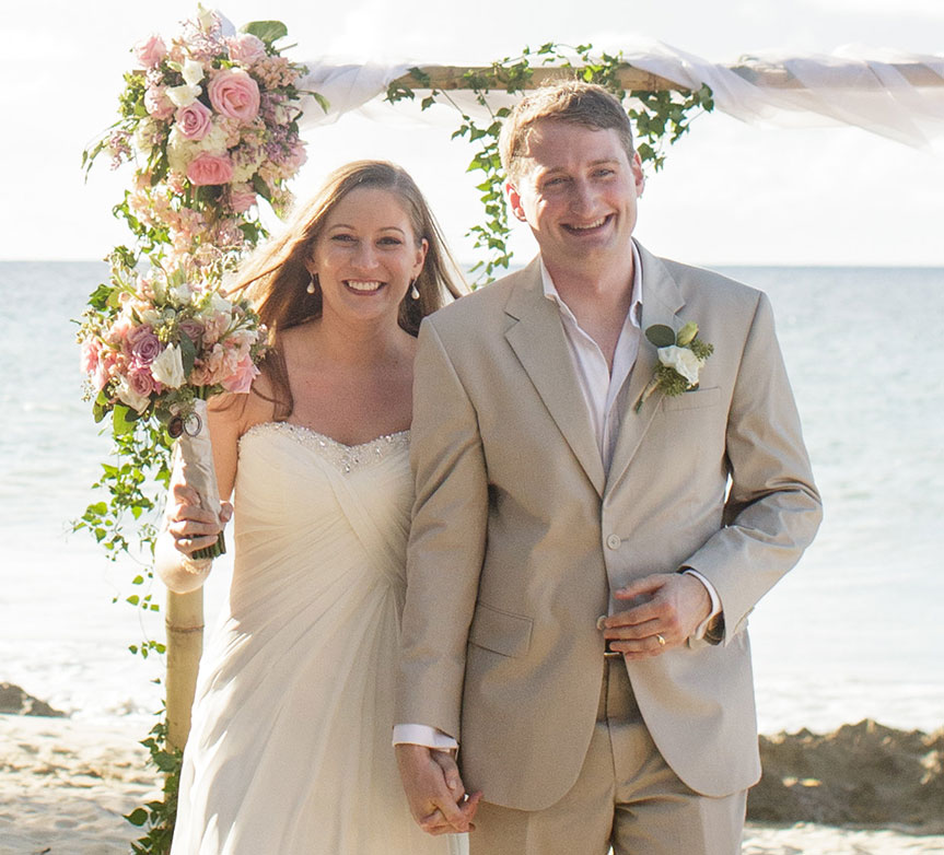 Bride and groom just married on the beach at their Caribbean destination wedding in St. Croix by Destination wedding planner Mango Muse Events