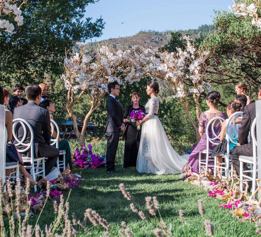 Bride and groom wedding ceremony Calistoga ranch Destination wedding planning and design by Mango Muse Events