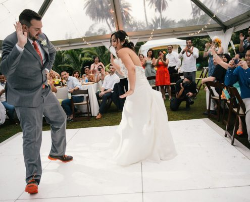 Lively first dance at a Hawaii destination wedding by Destination wedding planner Mango Muse Events