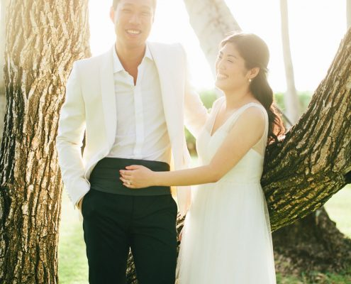 Happy couple laughing at their Hawaii destination wedding by Destination wedding planner Mango Muse Events