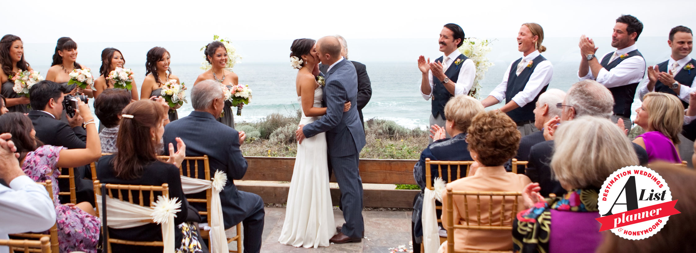 Guests clapping at a wedding ceremony in Half Moon Bay by Destination wedding planner Mango Muse Events
