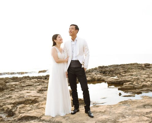 Bride and groom enjoying the scenery at their Hawaii destination wedding by Destination wedding planner Mango Muse Events