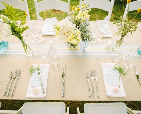 Soft yellow and blue wedding tablescape for a Hawaii destination wedding by Destination wedding planner Mango Muse Events