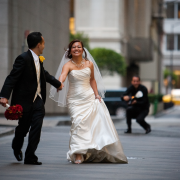Bride and groom running from photographer. San Francisco wedding by destination wedding planner Jamie Chang of Mango Muse Events.
