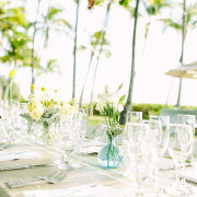 Flowers and table setup for a Hawaii destination wedding by Destination wedding planner Mango Muse Events