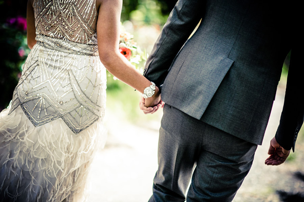A wedding couple holding hands at their Sonoma destination wedding reflecting their unique wedding style