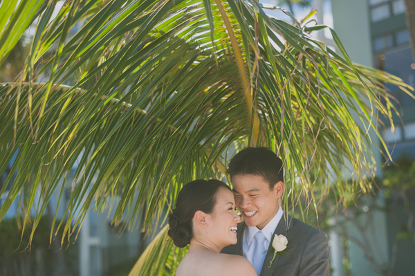 Wedding couple enjoying a moment in the shade at Hawaii destination wedding on a small wedding budget by Destination wedding planner Mango Muse Events