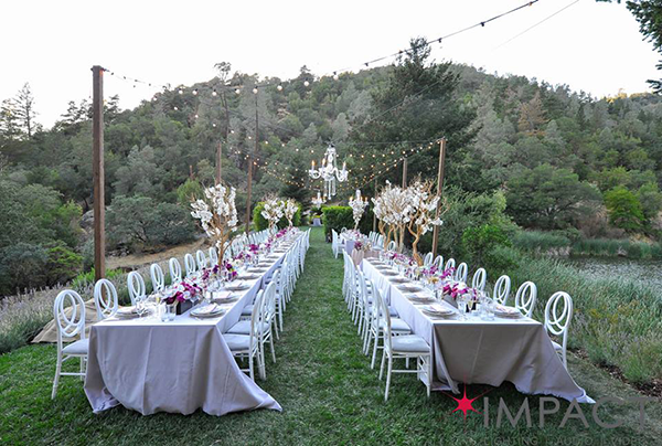 Dining setup at Calistoga Ranch with lighting by Impact SF and designed by Destination wedding planner Mango Muse Events