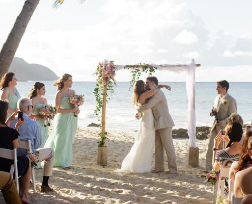 Bride and groom getting married on the beach at their US Virgin Islands destination wedding in St. Croix in the Caribbean planned by Destination wedding planner Mango Muse Events