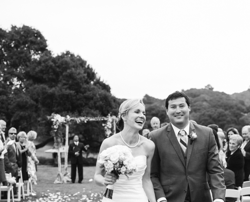 Bride and groom happily walk down the aisle after getting married at their Carmel destination wedding ceremony by Destination wedding planner, Mango Muse Events