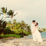 A couple on the beach for their Hawaii destination wedding by Destination wedding planner, Mango Muse Events