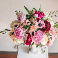 Pink floral centerpiece made by wedding florist, Petite Petal Co.