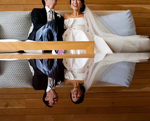 Bride and groom laughing and enjoying a moment at their San Francisco wedding planned by Destination wedding planner, Mango Muse Events