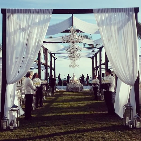 Reception setup with chandeliers and champagne with rentals by Bright Event Rentals