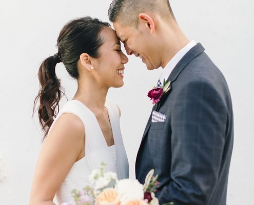 Couple sharing a moment at their wedding with Hair and Makeup by Skyla Arts and Photo by Delbarr Moradi