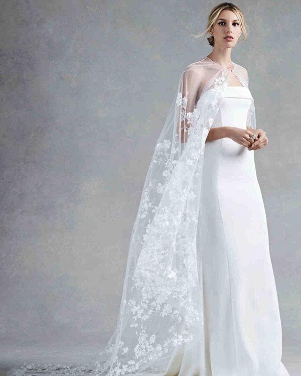 Sheer cape wedding dress from the Oscar de la Renta bridal fashion week Fall 2017 collection