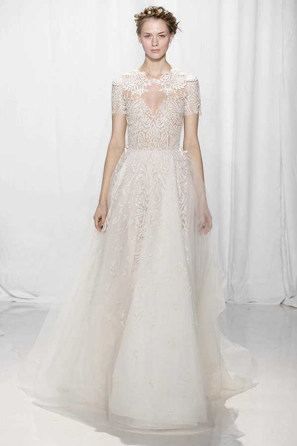 c7bb1f4189 Sheer wedding dress from the Reem Acra bridal fashion week Fall 2017  collection