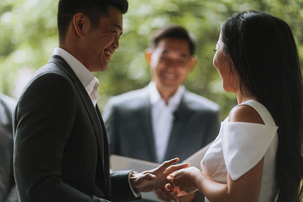 Bride and groom in their Vancouver wedding ceremony officiated by a friendor and planned by Destination wedding planner, Mango Muse Events