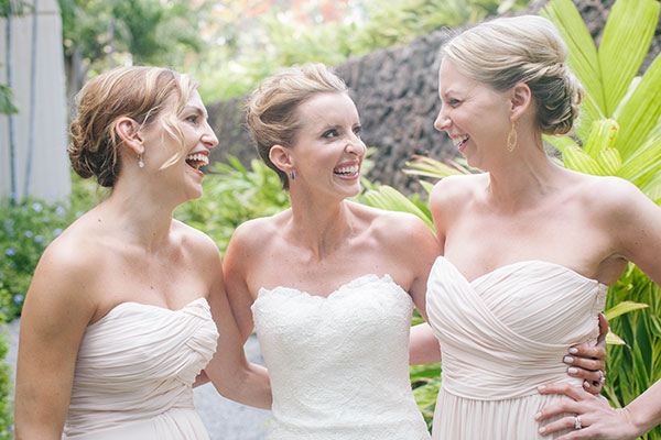 Bride and bridesmaids laughing at a Big Island destination wedding by Destination wedding planner, Mango Muse Events