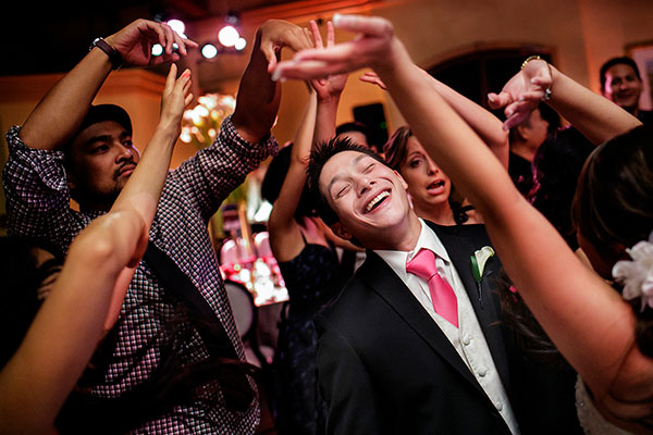 Groom laughing and dancing at a wedding reception at a Sonoma destination wedding by Destination wedding planner, Mango Muse Events