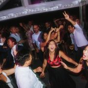 Wedding guests having a great time dancing and singing at a Vancouver destination wedding reception by Destination wedding planner Mango Muse Events